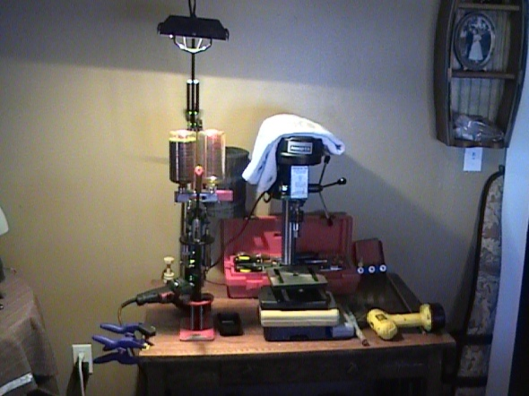 For the best roll crimps I can achive I find that a drill- press is great. I purchased this one new for less than a hundred dollars.